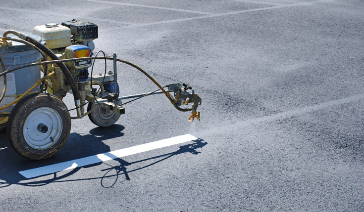 Parking lot striping in cedar rapids iowa city ehc for Parking lot painting equipment